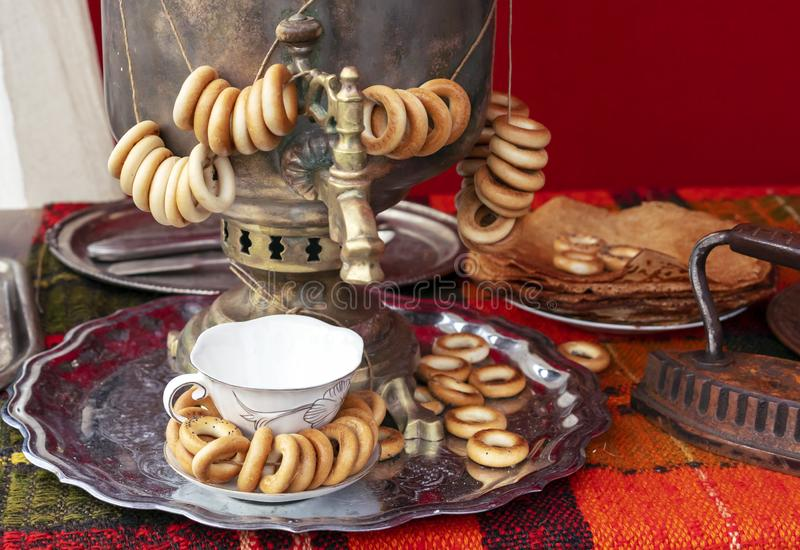 Russian traditional samovar with bundles of bagels royalty free stock images