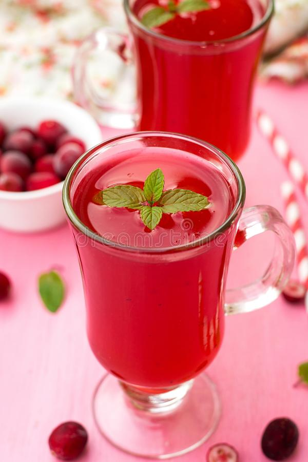 Russian traditional drink kissel with cranberries and mint royalty free stock image