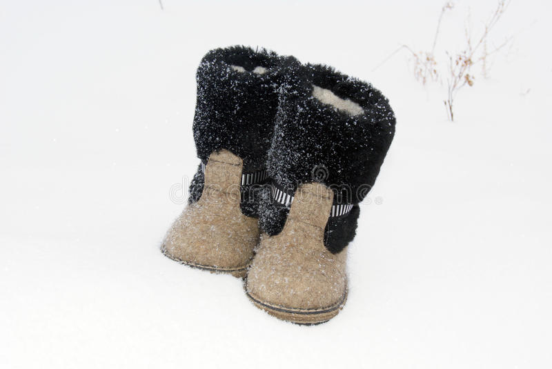 Russian traditional winter felt boot valenki on the snow stock image