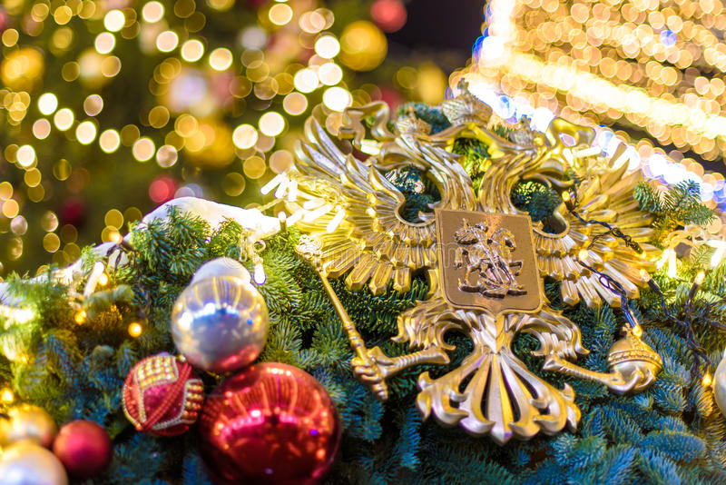 Russian two-headed eagle. Russian coat of arms two-headed eagle and Christmas decorations stock photos