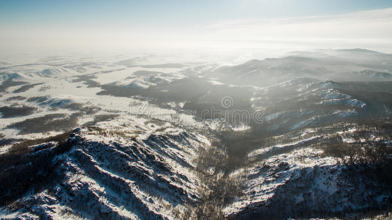 Russian Ural mountains in winter. Aerial view lake, white infinity. Russian Ural mountains in winter. Aerial view of the lake and the endless landscapes stock photo