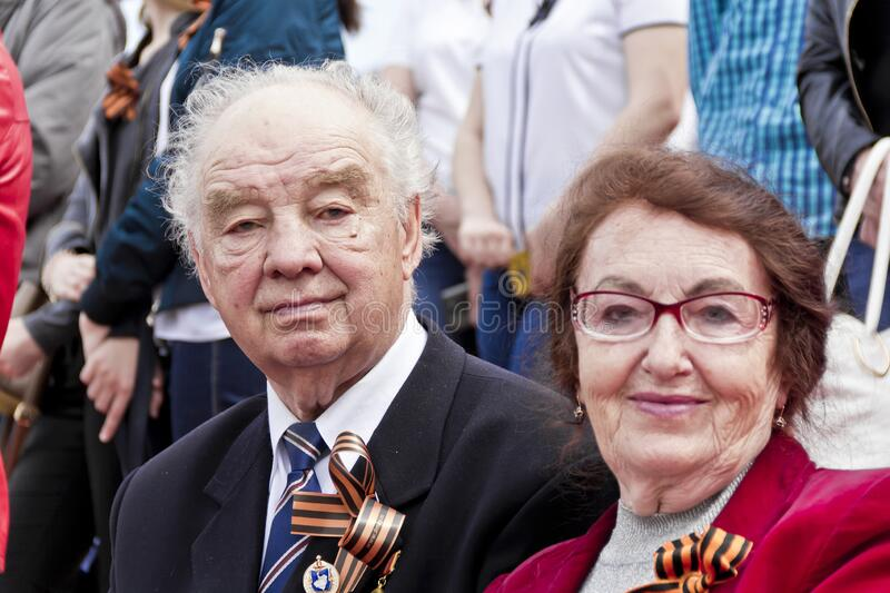 Russian veteran with wife on celebration at the parade annual Victory Day, May, 9, 2017 in Samara, Russia royalty free stock photos