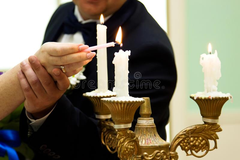 Russian wedding. Lighting candles, symbolizing the home in the registry office stock photos