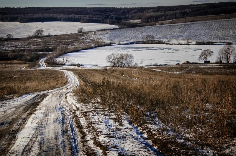 Russian winter landscape. Typical russian winter landscape with a road royalty free stock photography