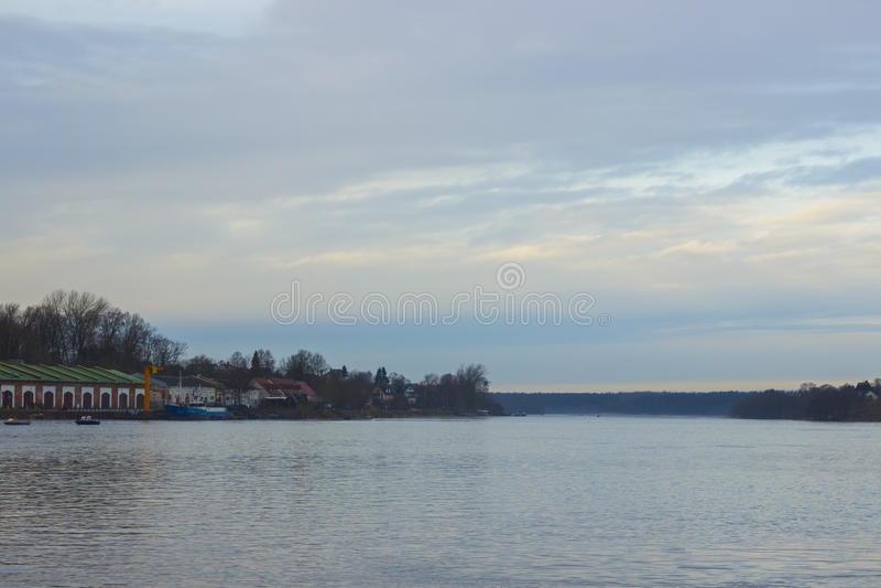 Russian winter sky above the Narva river stock photo