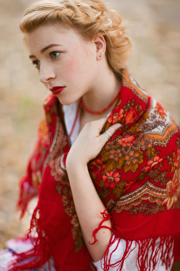 Russian woman. Portrait of beautiful woman in russian traditional dress royalty free stock images