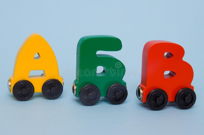 Russian wooden letters train alphabet. Bright colors of red yellow green on a white background. Early childhood education, learnin. Russian wooden letters train stock photography