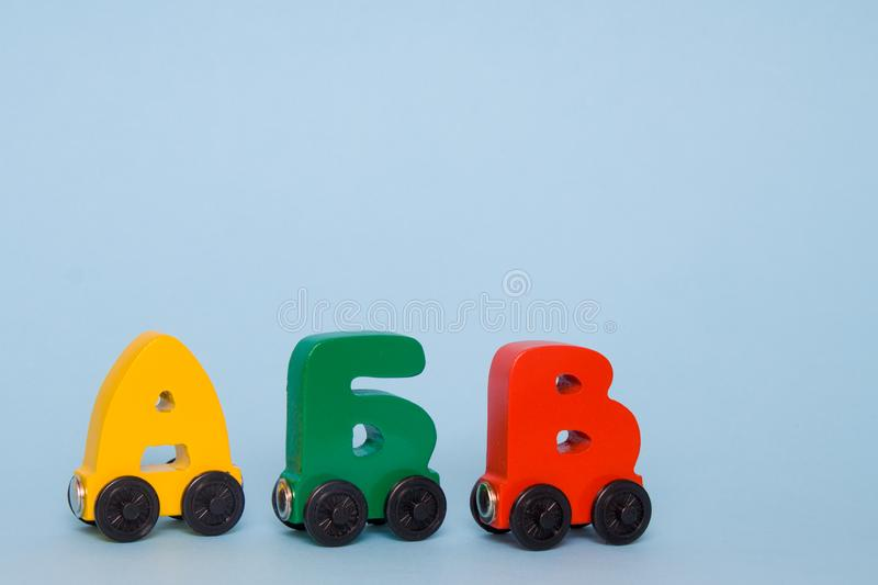 Russian wooden letters train alphabet. Bright colors of red yellow green on a white background. Early childhood education, learnin. Russian wooden letters train royalty free stock images
