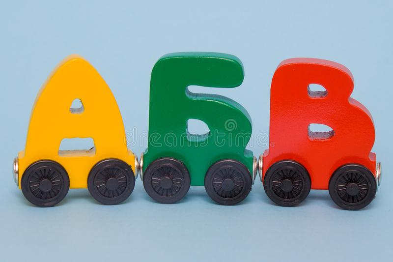 Russian wooden letters train alphabet. Bright colors of red yellow green on a white background. Early childhood education, learnin. Russian wooden letters train royalty free stock image