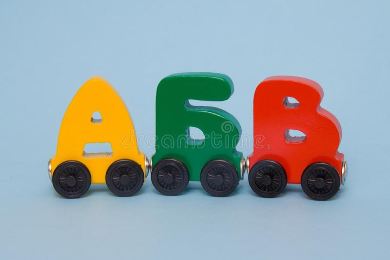 Russian wooden letters train alphabet. Bright colors of red yellow green on a white background. Early childhood education, learnin. Russian wooden letters train stock images