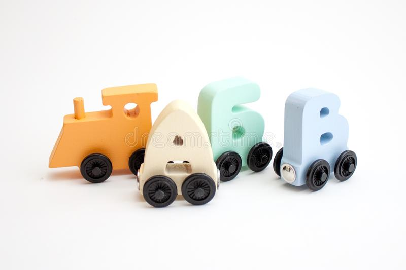 Russian wooden letters train alphabet with locomotive. Light shades colors. Early childhood education, learning to read, preschool. And kids game concept stock photo