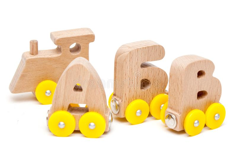 Russian wooden letters train alphabet with yellow wheels on a white background. Early childhood education, learning to read, presc. Hool and kids game concept stock photos