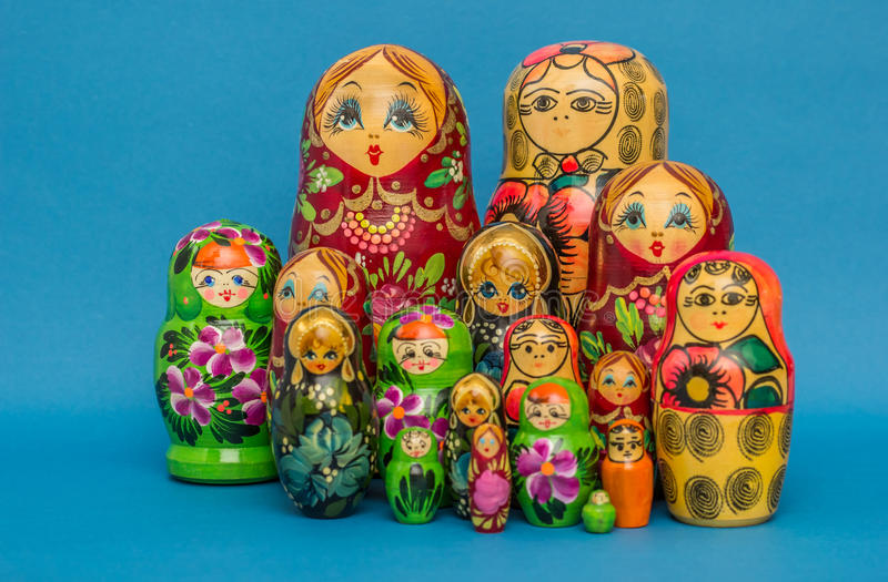 Russian wooden nesting dolls. Against a blue background stock photo