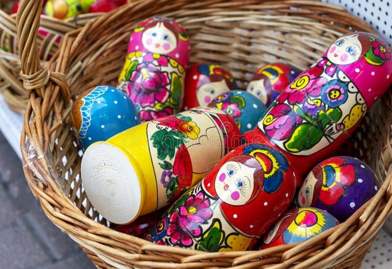 Russian wooden souvenir dolls matryoshka in a wicker basket.  stock photo