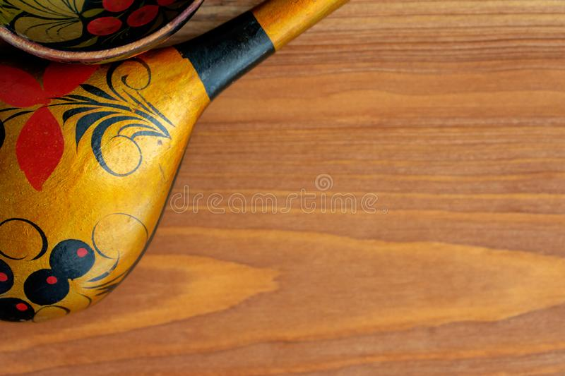 Russian wooden spoon on brown background stock photo