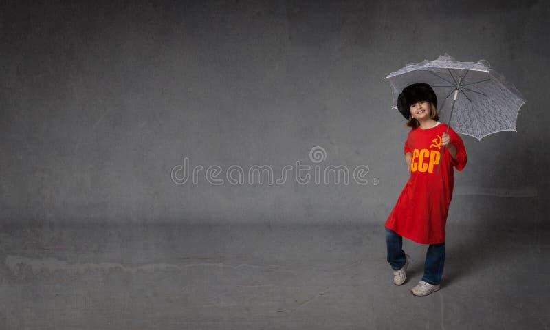 Russisch kind met paraplu stock fotografie