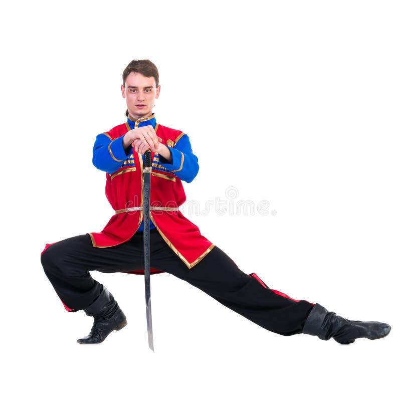 Russische cossackdans Het jonge danser stellen met zwaard royalty-vrije stock fotografie