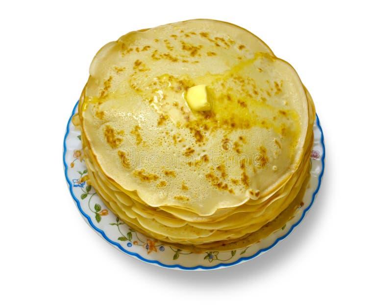 Russische Pfannkuchen mit Schmieröl lizenzfreies stockfoto