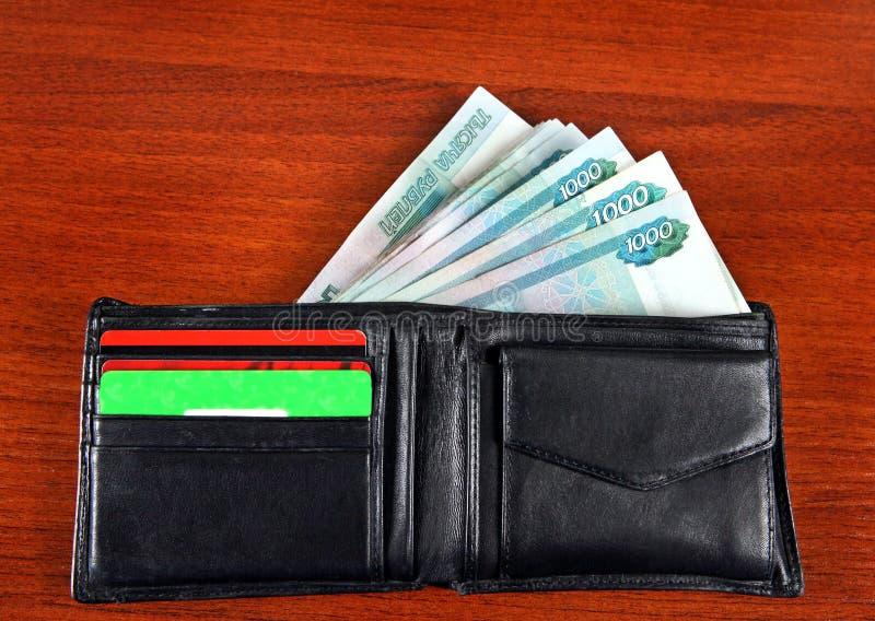 Russische Währung in der Geldbörse lizenzfreies stockbild