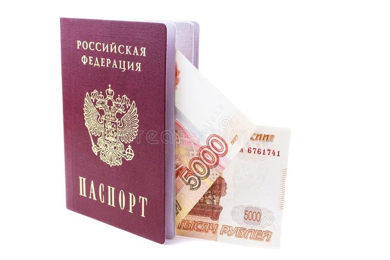 Russischer Pass und Rubel Banknoten stockfotografie