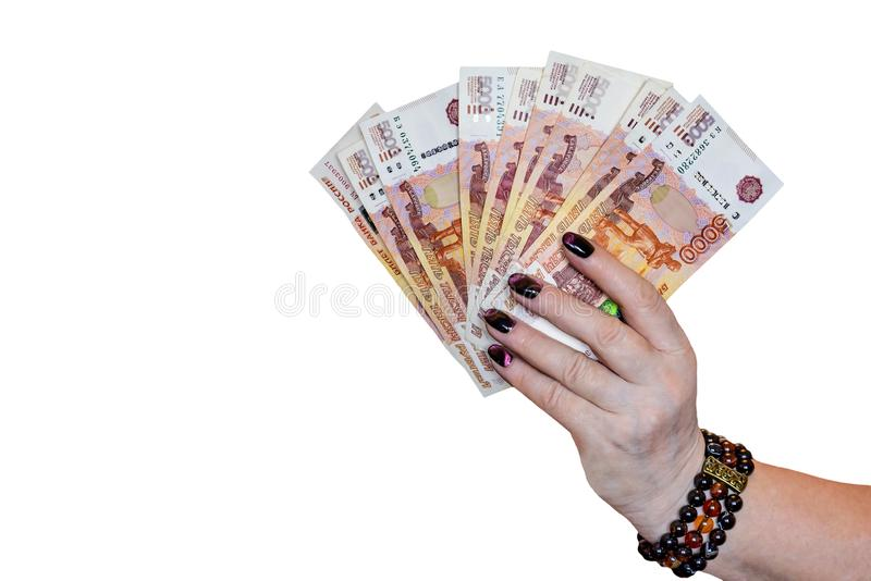 Russisches Geld in einer gut-gepflegten weiblichen Hand lockerte heraus lokalisiert auf einem weißen Hintergrund auf lizenzfreie stockbilder