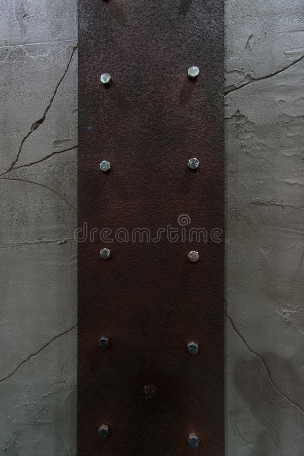 Rust corroded surface metal plate on crack wall peeling paint. royalty free stock photos