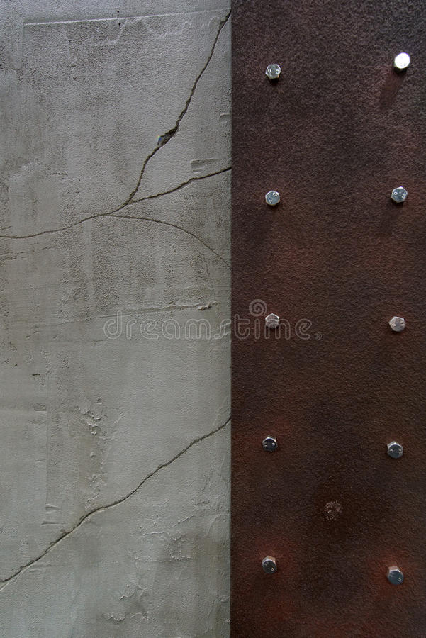 Rust corroded surface metal plate on crack wall peeling paint. stock image