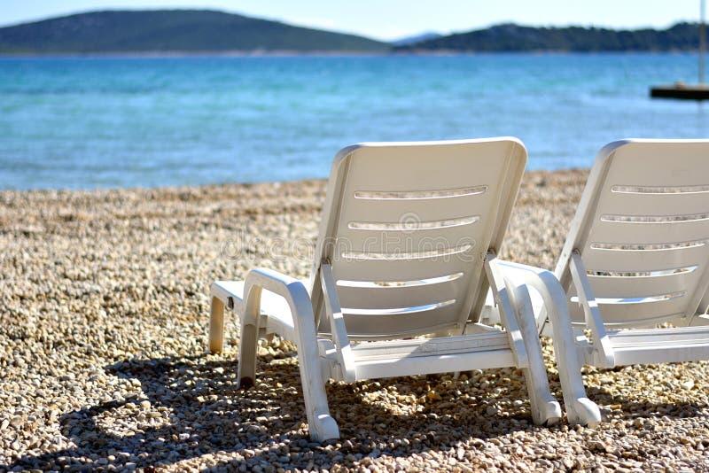 Rust, de zomerontspanning en het zonnebaden concept stock afbeelding