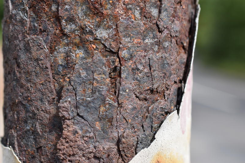 Rust on Light Pole. Light pole with abstract rust pattern stock photography