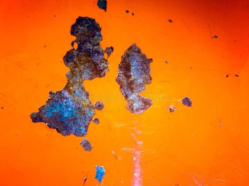 Rust on the orange metal sheet royalty free stock photos