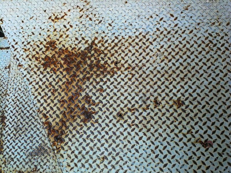 Rust pattern on the metal floor. Metallic royalty free stock photography