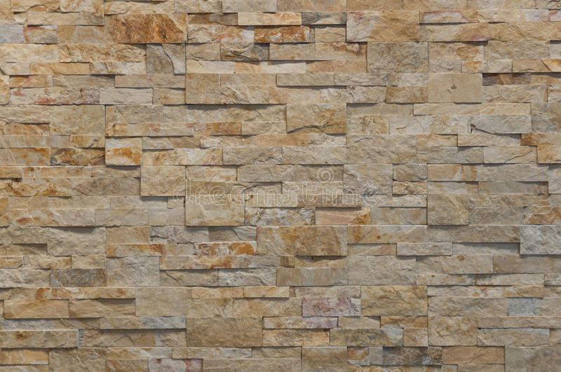 Rust stone wall. Stone wall detail, for construction, business, designers, home, interior and exterior decoration applications