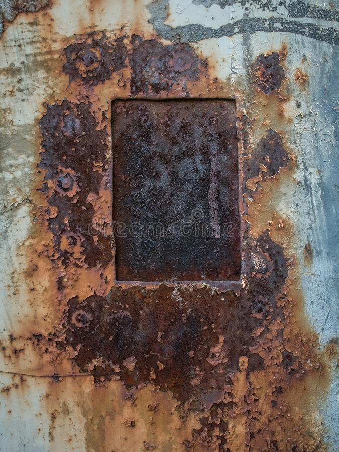 Rust texture with metal plate, abstract grunge background royalty free stock photo