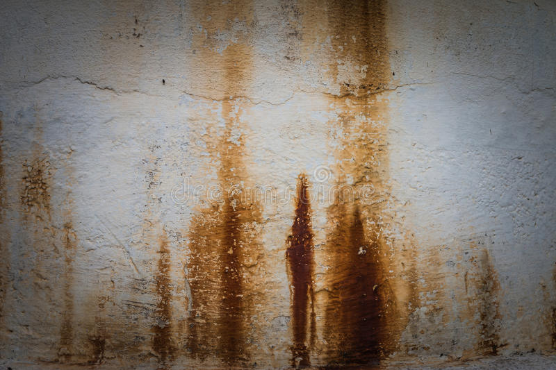 Rust texture on the wall. Weathered white wall with rust texture stock photo