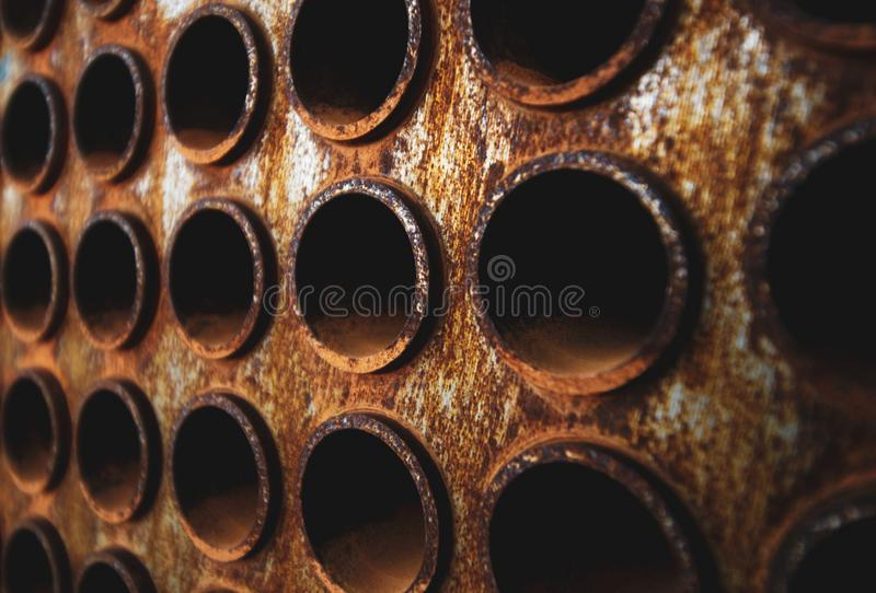 Rust tube sheet of the heat exchanger for maintenance, the water heater in the boiler as background with warm Contrast tone stock image