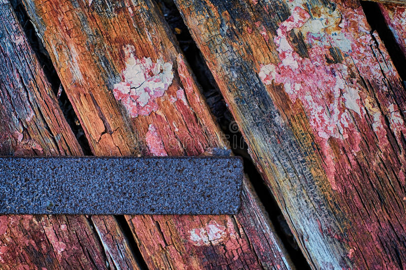 Rust and Weathered Wood. Colorfully Painted and colorful weathered wood with rusting iron holding together an old rudder found on the Chesapeake bay stock photo