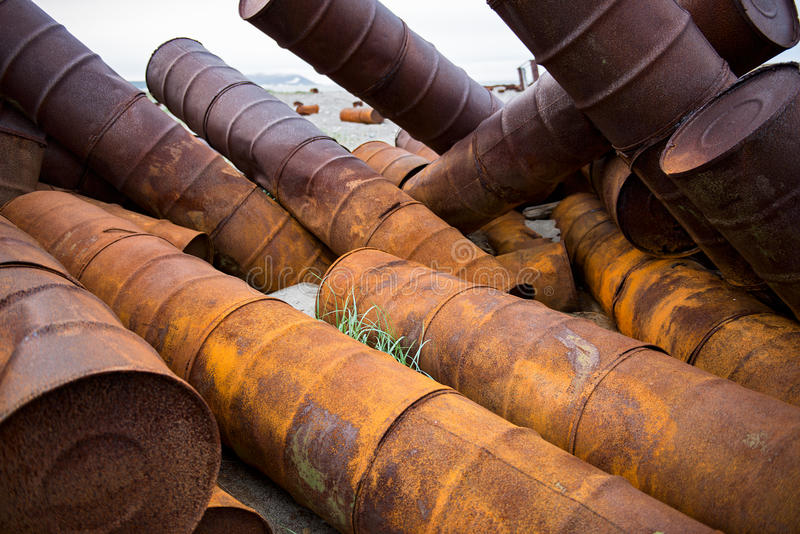 Rusted barrels on the shore. Rusted barrels on the shore, Chukotka, Russia stock images