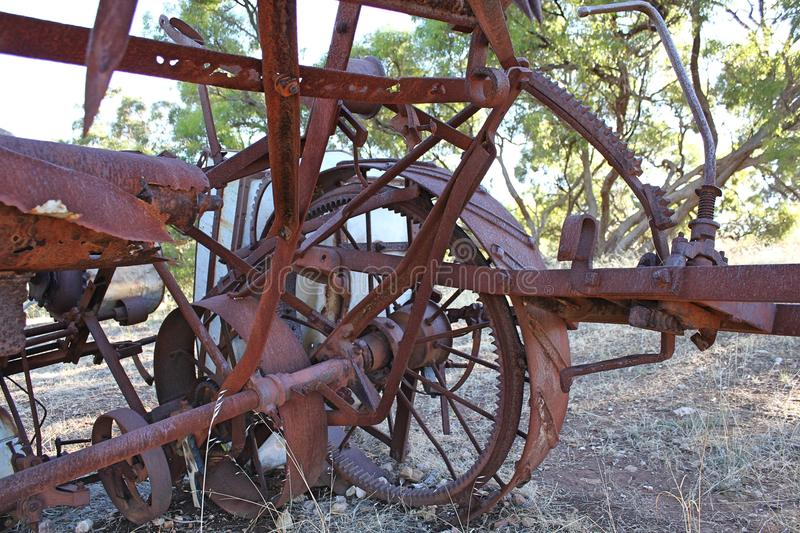 Rusted Farm Equipment. In country setting royalty free stock image