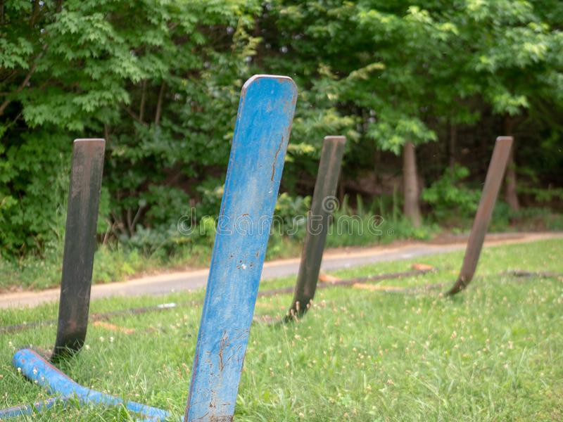 Rusted football sleds with no pads sitting in an empty practice field stock image