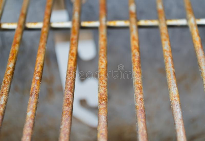 Rusted Grill Bars Vertical. Rusted metal grill bars pictured vertically showing signs of deterioration stock photos