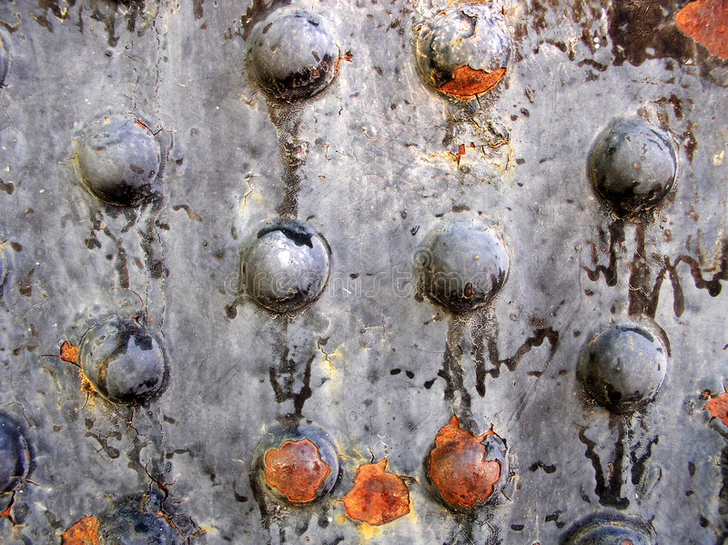 Rusted metal rivets. On the side of an old granary - horizontal view stock photos
