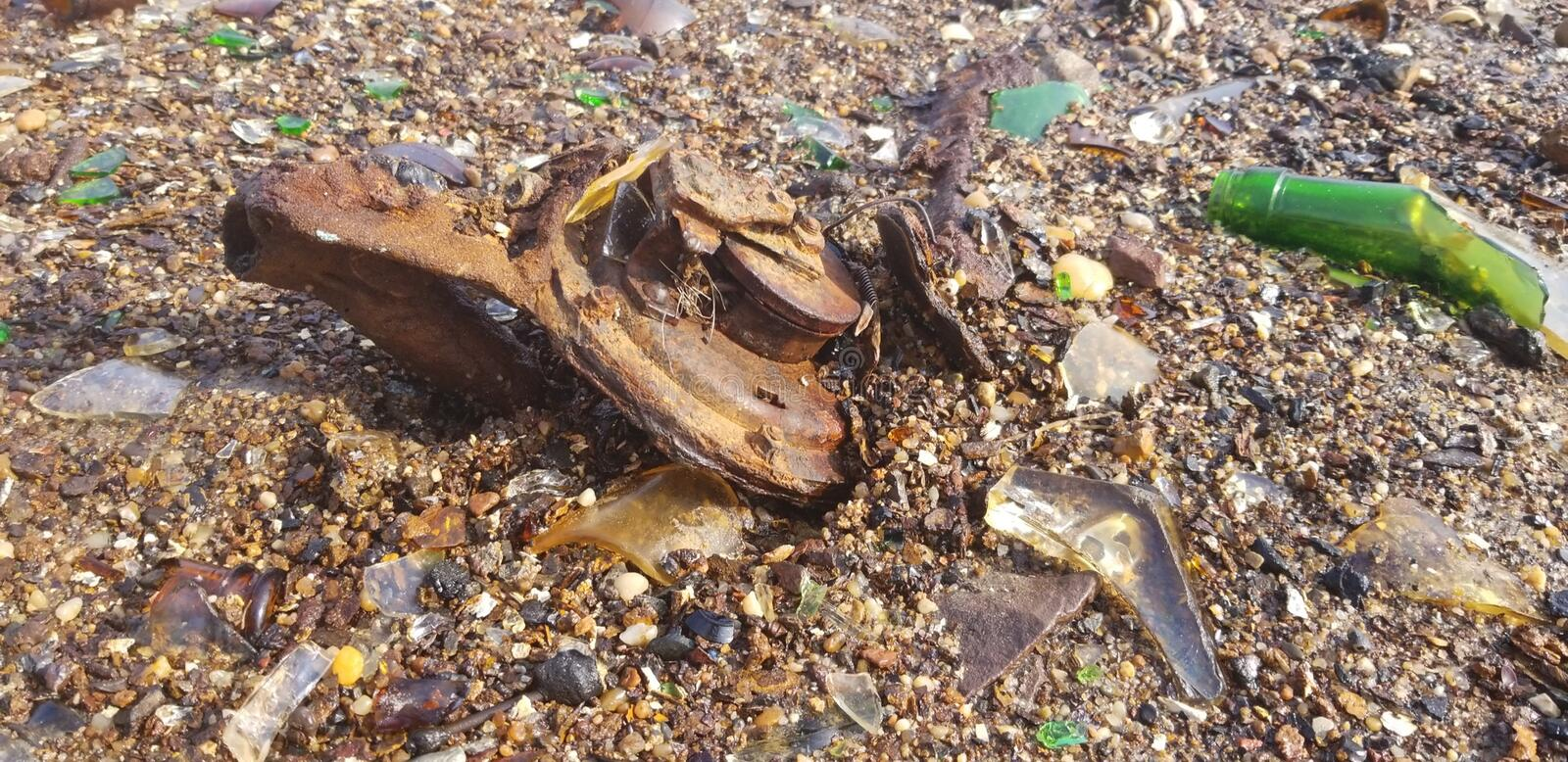 Rusted Metal in the Sand royalty free stock image