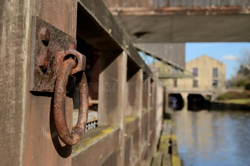 The rusted mooring ring. Rusted mooring ring at the Wigan Pier, Wigan, England stock image