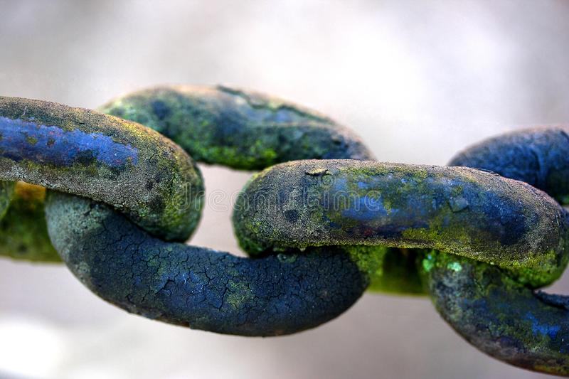 Old chain links. Rusted old chain links with green mould or rust royalty free stock photography