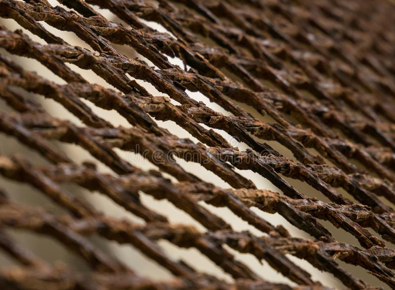 Rusted, old, corroded metal mesh fence, closeup at 45 degree angle. With shallow depth of field royalty free stock images