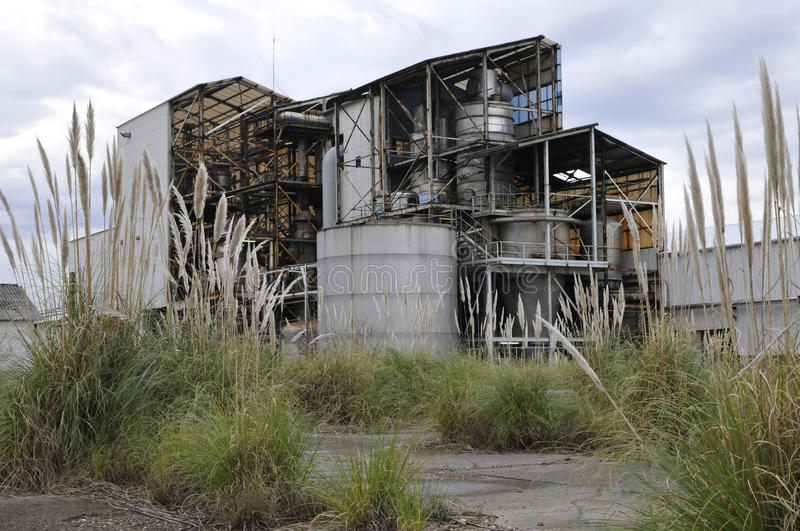 Download Rusted And Old Factory With Vegetation Stock Image - Image: 25169243