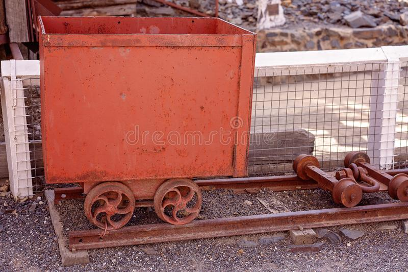 Rusted Old Trolley From Abandoned Gold Mine. Rusted iron gold mining equipment now used as part of a tourist attraction at an abandoned gold mine royalty free stock image