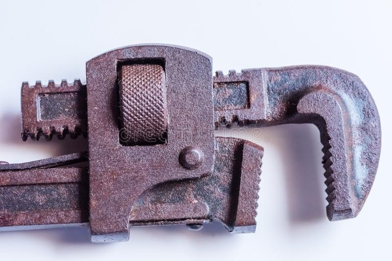 Rusted Pipe Wrench handtool in white background. Closeup of rusted pipe wrench hand tool in isolated background stock photos