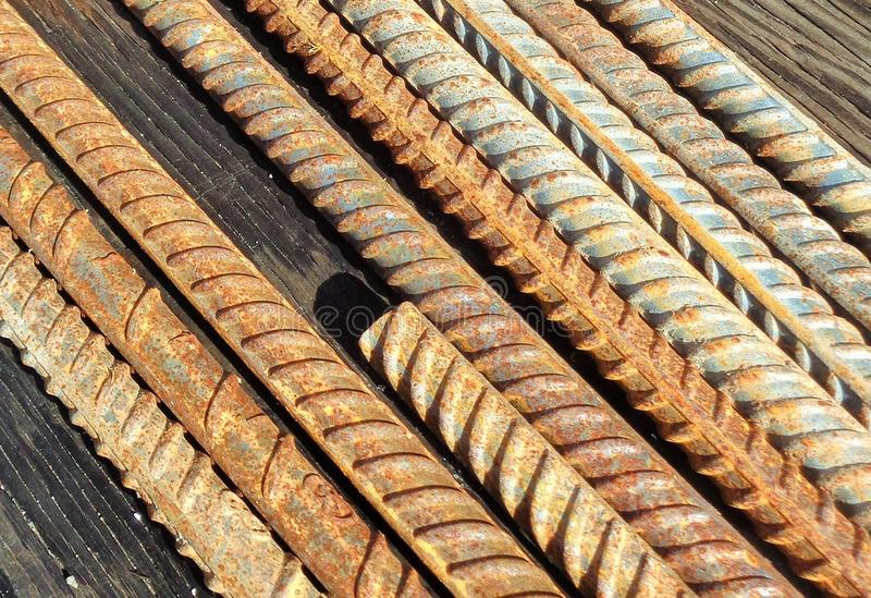 Rusted Rebar on a Wooden Workbench royalty free stock image
