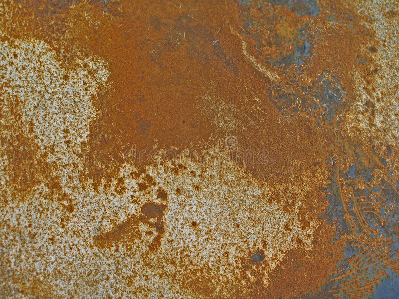 Rusted & Scratched Metal Panel. Rusted and scratched metal car panel, showing good detail of rust spots and scratches on the paint work stock photo